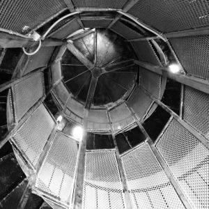 Looking up the spiral staircase at the observation tower that's open to the public at Fort Miles