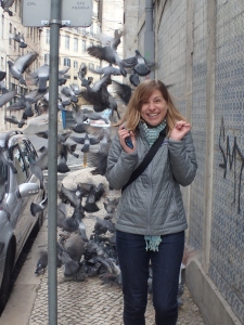 Playing with pigeons in Lisbon led to this awesome photo, and bird poop on my head....